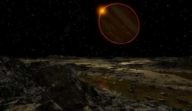Júpiter y el Sol vistos desde la Luna Europa.