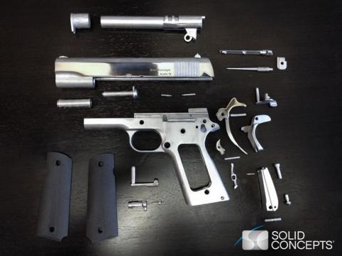 Pistola de metal con impresora 3D