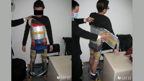 Intenta pasar la aduana de China con 94 iPhones 6 pegados al cuerpo.