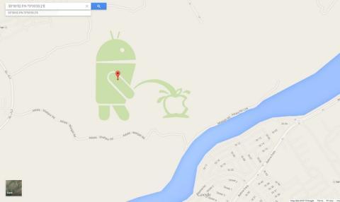 Robot de Android se orina en el logo de Apple